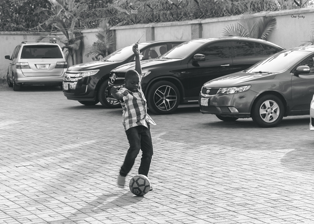 a boy about to kick a football